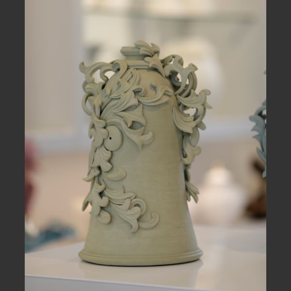 grey decorative stoneware vase sculpture with ornate floral trim
