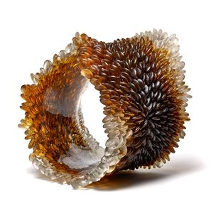 amber and brown contemporary textured organic art-glass sculpture made from cast and sculpted glass