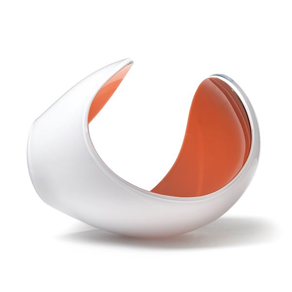 white and peach glossy contemporary rounded art-glass sculpture made from blown and cut glass