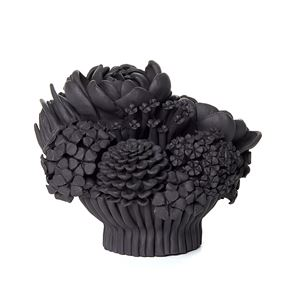 black stoneware sculpted artwork of mixed flowers
