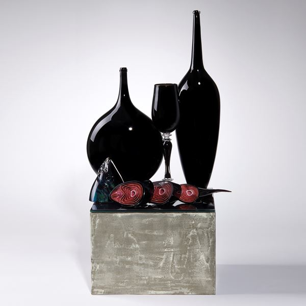 black and red contemporary art glass sculpture with vases and cut fish