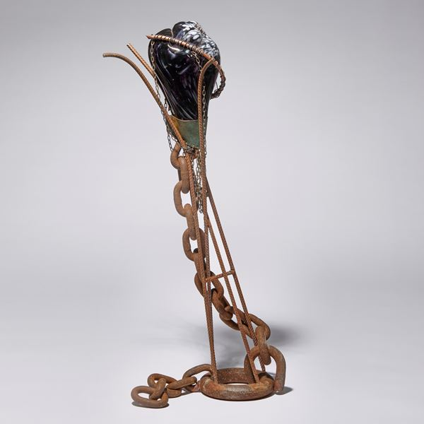 black and rust contemporary mixed media abstract figurative sculpture made from blown glass and rusty metal