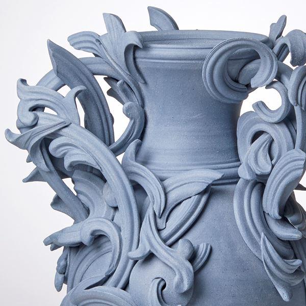 blue ceramic vase with decorative classical trim