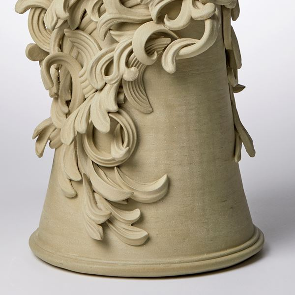 grey decorative stoneware vase sculpture with ornate floral trim