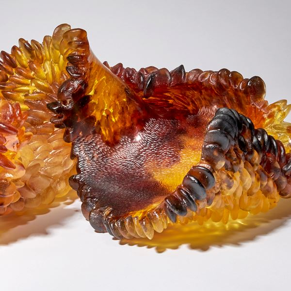 amber red and brown contemporary textured art-glass sculpture made from cast glass