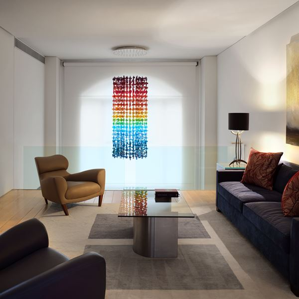 multicoloured contemporary abstract hanging sculpture made from many handmade glass elements