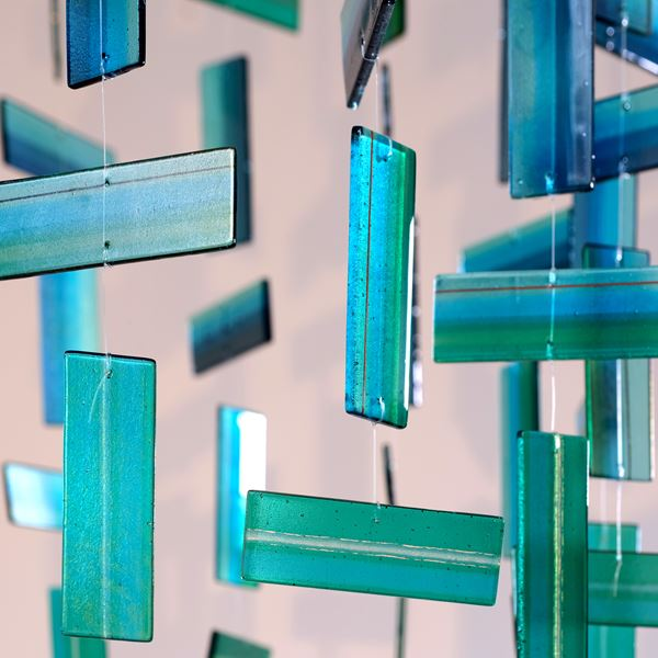 Aqua amber and green contemporary abstract hanging sculpture made from many handmade glass elements