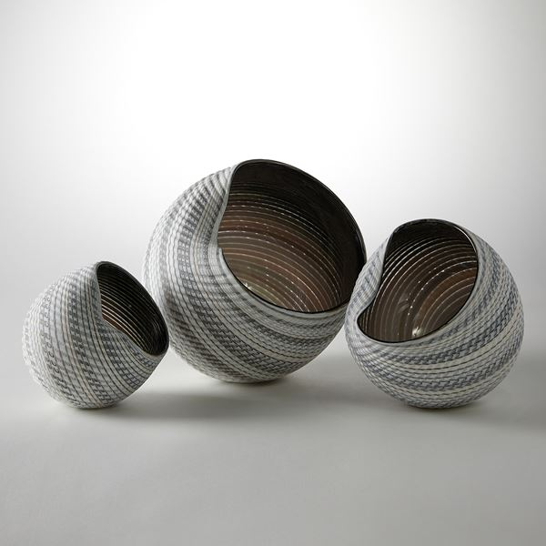 handblown and cut glass contemporary sculpture with swirling pattern