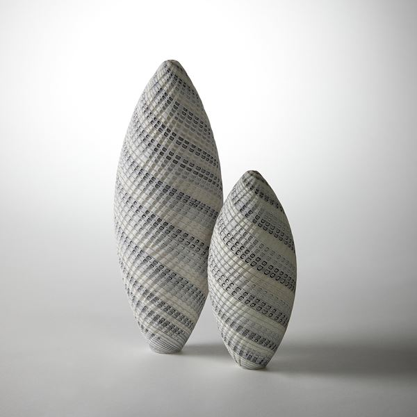 grey and white contemporary sculptural vessel with swirling pattern made from handblown and cut glass