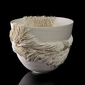 sculptural ceramic decorative bowl with ribbed textured detail handmade from porcelain