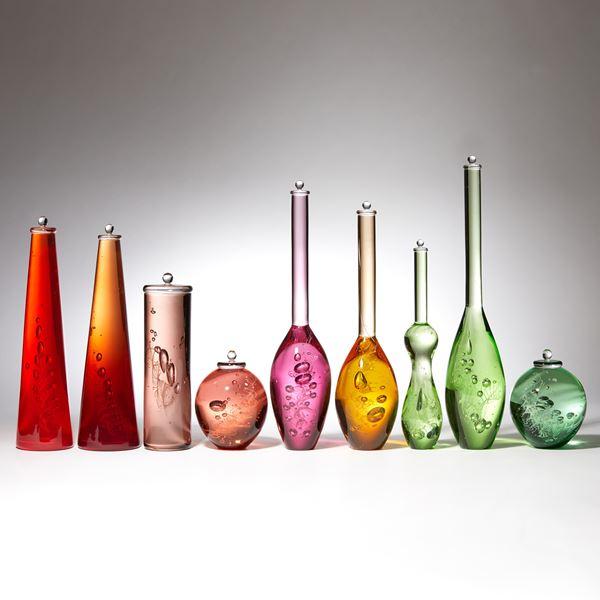 multicoloured scientific bottles installation created from handblown glass