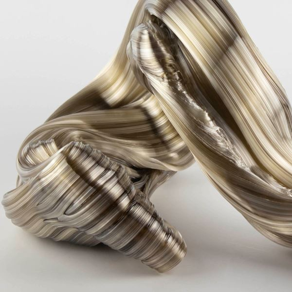 glossy bronze organic ridged twisting candy like sculpture handmade from glass