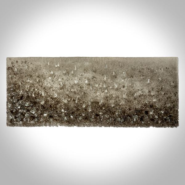 bronze and clear crystal adorned wall mounted organically textured artwork on a lacquered backboard