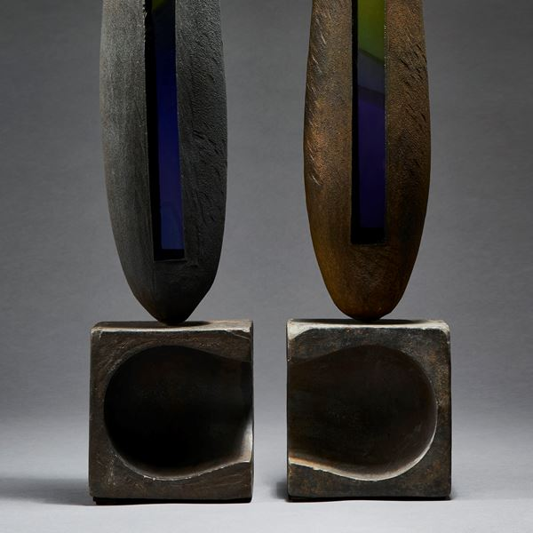 grey brown green and blue tall pointed aged looking twinned sculptures with weathered appearance handmade from blown glass and steel