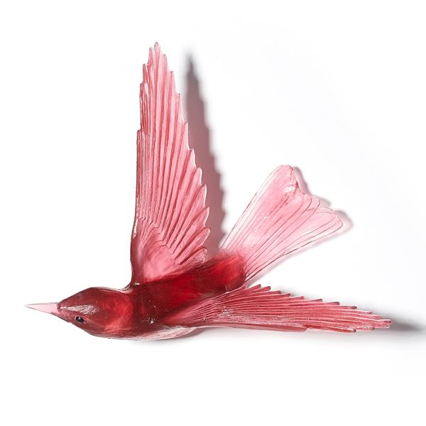 glass sculpture of a bell bird in deep pink