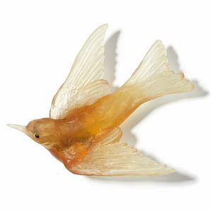 glass sculpture of swallow bird in yellow gold