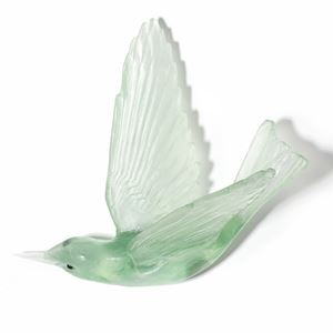 light green art glass sculpture of a bird
