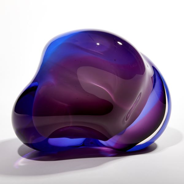 layers of white blue and purple glass create an amorphous handmade sculpture