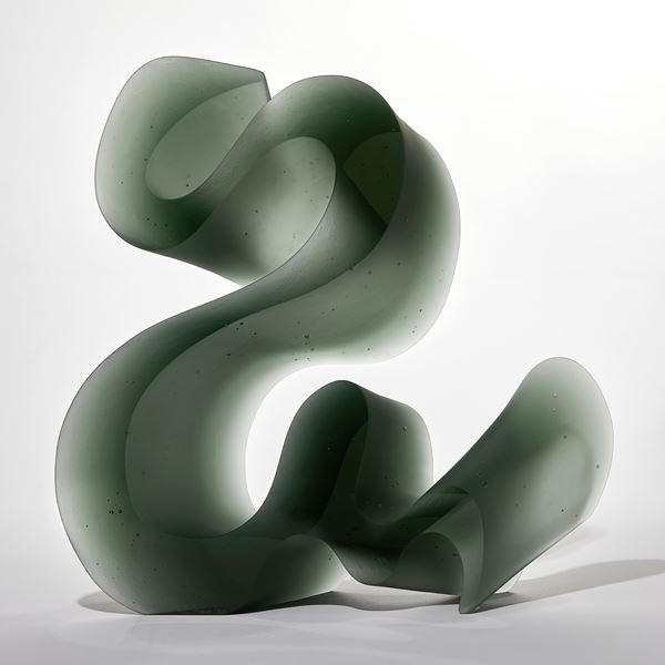 green abstract line sculpture made from cast glass