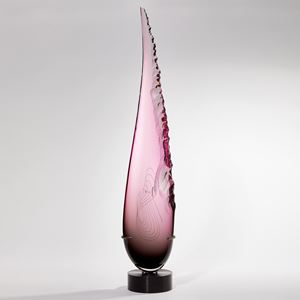 Long teardrop form in pink with one soft edge and chipped detail on the other handmade from glass