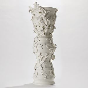 tall ceramic sculptural column covered in organic swirls and flourishes handmade from porcelain