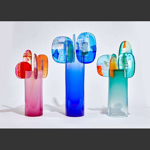 bright blue and pink abstract lollipop style sculpture handmade from glass