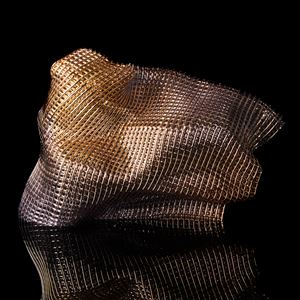 standing woven soft form with gold appearance handmade from canes of glass