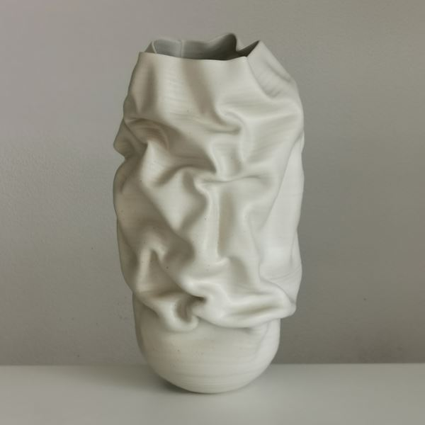cream crumpled tall vessel with slash handmade from clay