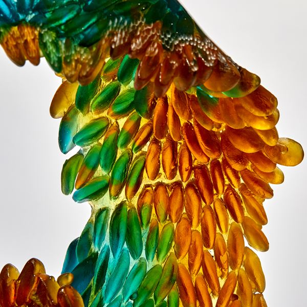 green turquoise and amber continuous ringed scaled sculpture made from glass