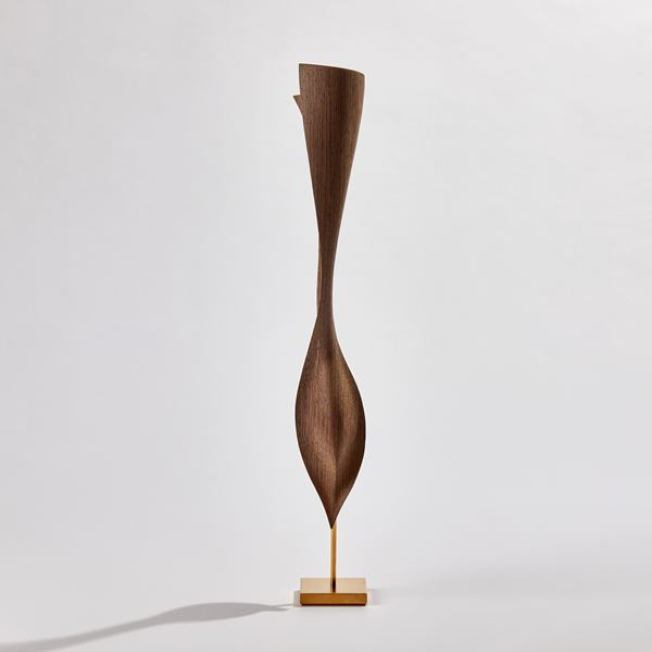 wave like form in wood on gold base handmade with gold detail