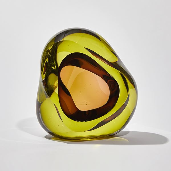 amorphic shaped handmade glass sculpture in lime and purple with centre cavity opening
