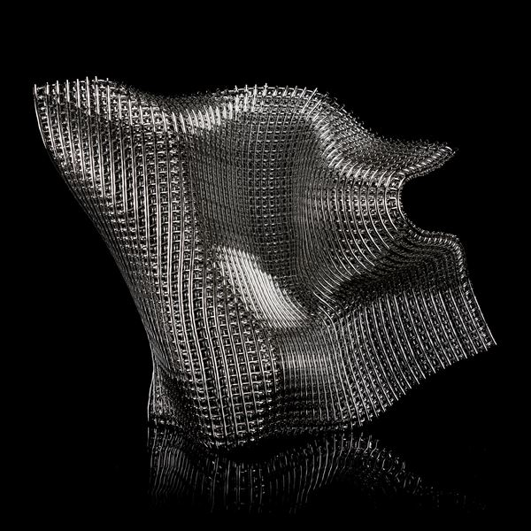 asymmetric organic standing sculpture with the appearance of chunky woven metallic cloth