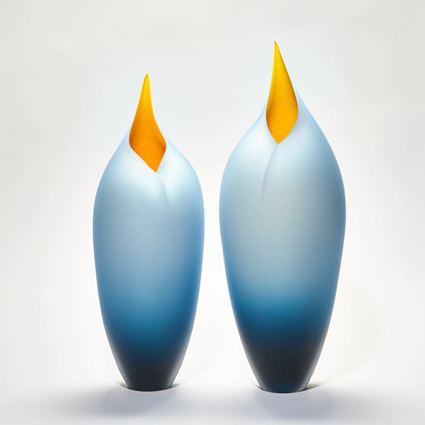 handblown abstract minimalist glass sculpture of blue and orange birds