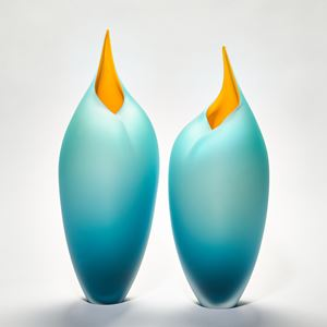 Sleek tall simplified bird form handmade glass sculpture in teal and yellow