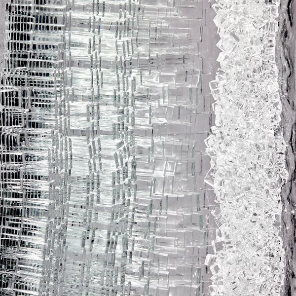 monolithic rock like handmade sculpture in  black grey and clear glass with crystal interior detail