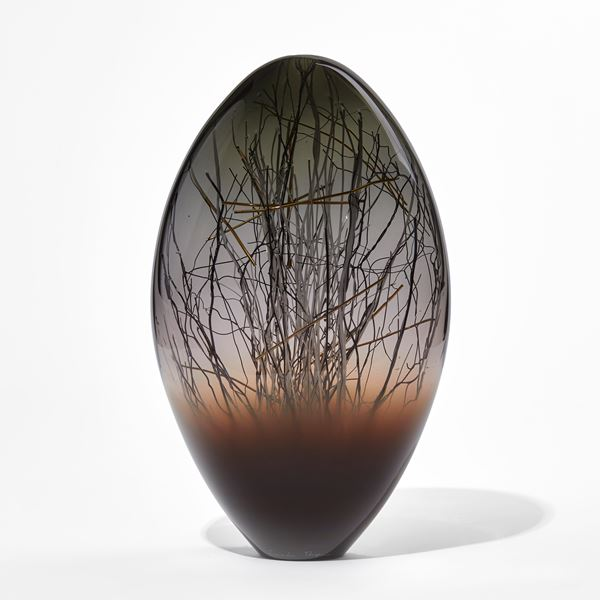 dark brown grey and black ovoid handmade glass sculpture with inner line detail in black and gold