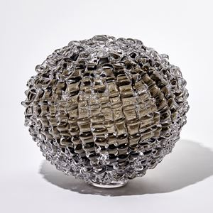 browny grey round handmade glass sculpture with rippled surface