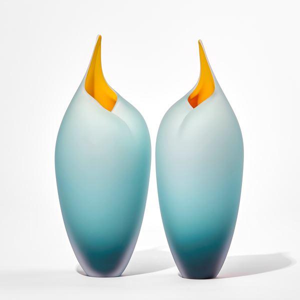 teal tall bird handmade glass sculptures with open beaks and yellow mouths