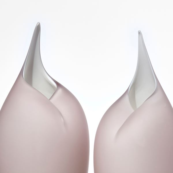 two modern art glass sculptures in bird like shape in white and light grey