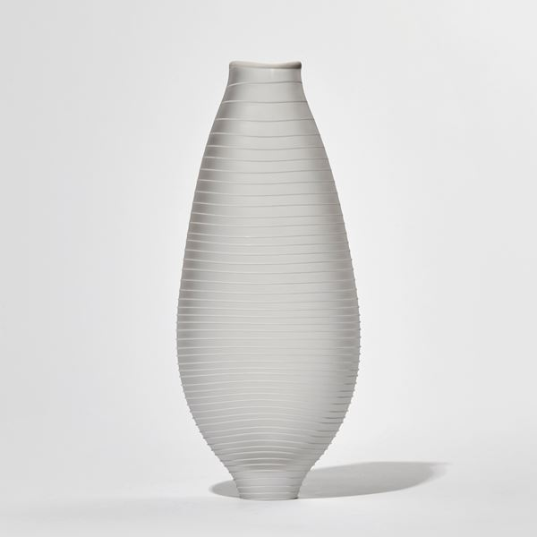 matt clear teardrop shaped handmade glass vase with raised white line circling from top to bottom
