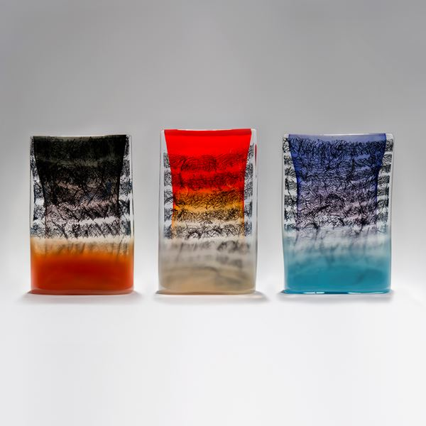 Rectangular standing glass sculpture in purple blue and clear glass with encased scribbled black lines
