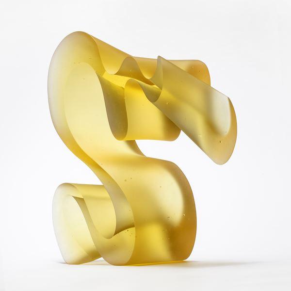 yellow standing curling line sculpture handmade from cast glass
