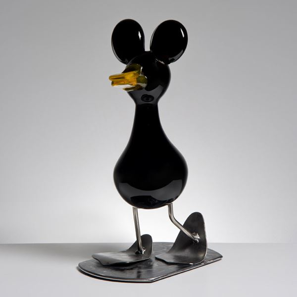 decorative blown glass ornament of a cartoon duck with steel legs and base