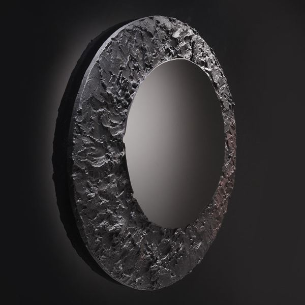 round black mirror glass artwork with cratered edge