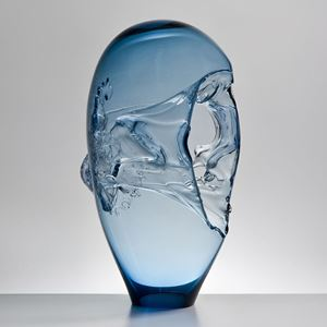 light blue seethrough oblong-shaped glass-art sculpture vessel with handle and abstract pattern
