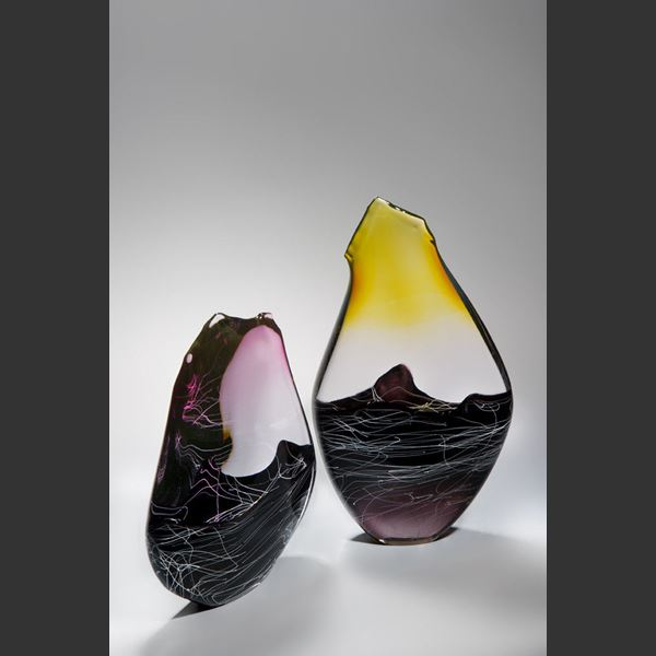 blown and sculpted glass ornament in abstract teardrop shape in black clear and pink