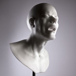 bust of head with agonised face made from glass