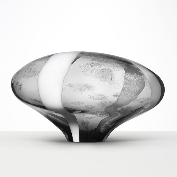 abstract brain-shaped clear glass sculpture in clear and grey with faint cloud like patterns throughout