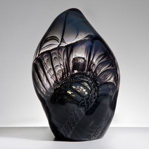 handblown and sculpted leaf-shaped glass art ornament in carbon with external embossed and engraved pattern