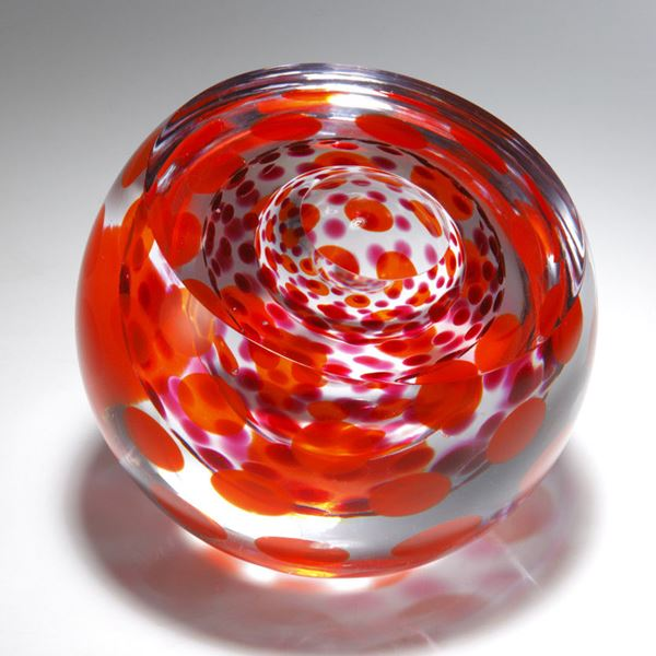 three rounded art glass sculptures in purple and red